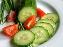 Cucumber and tomatos. Fresh vegetables and chive Stock Photography