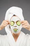 Cucumber Treatment. Image of a model with a full cucumber treatment Royalty Free Stock Photography