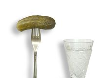 A cucumber  and vodka. A cucumber on a plug and vodka Royalty Free Stock Photography