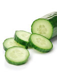 Cucumber on White. Cucumber and slices isolated over white background Royalty Free Stock Photography