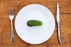 Cucumber on white plate Royalty Free Stock Images