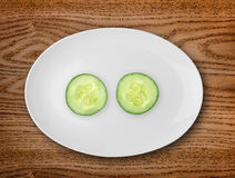 Cucumber in the white plate  on wooden table Stock Photography