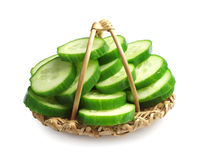 Cucumber in a wicker basket Stock Image