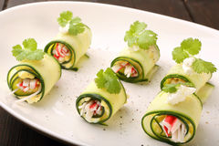 Cucumber wrapped with mashed eggs and surimi Stock Image