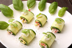 Cucumber wrapped with mashed eggs and surimi Stock Photo