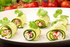 Cucumber wrapped with mashed eggs and surimi Royalty Free Stock Image
