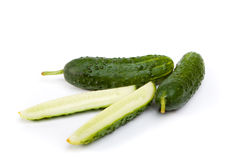 Cucumbers. Cucumber and slices isolated on white background stock images