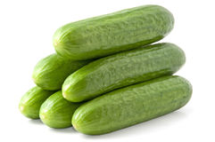 Cucumbers. Isolated pyramid of stacked cucumbers Royalty Free Stock Photography