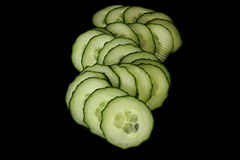 Cucumbers. Vegetables on a black background Stock Photos