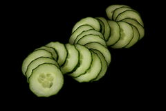 Cucumbers. Vegetables on a black background Stock Photography