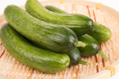 Cucumbers in basket. Some fresh cucumbers in basket Stock Photos