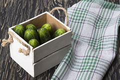 Cucumbers in a box. Cucumbers in a box on a wooden background Stock Photos
