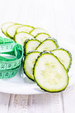 Cucumbers and centimeter. For dieting Stock Image