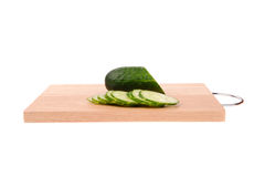 Cucumbers on the cutting board. Isolated on the white background Stock Image
