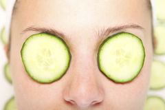 Cucumbers on eyes Royalty Free Stock Image