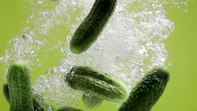 cucumbers falling down in water stock footage