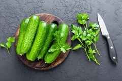 Free Cucumbers. Fresh Cucumbers On Wooden Board Stock Photography - 114063802