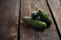 Cucumbers, freshly picked green cucumbers on a wooden background royalty free stock image