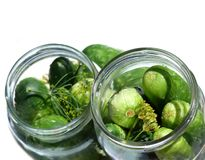 Cucumbers in jar. Cucumbers in glass jar on white stock photos