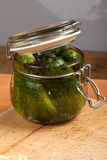 Cucumbers. In the jar on table Royalty Free Stock Photography