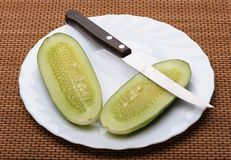 Cucumbers and knife Stock Photos