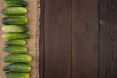 Cucumbers on the old dark table. Royalty Free Stock Photos