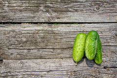 Cucumbers on the old wooden table Stock Photography