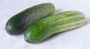 Cucumbers. 2 cucumbers place on unbleached cotton Royalty Free Stock Photography