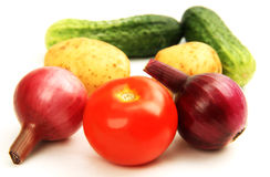 Cucumbers, potatoes, onions and tomato. Stock Photography