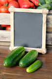 Cucumbers and price. Products on the market. Cucumbers and a price tag in a wooden frame. Price list for food royalty free stock images