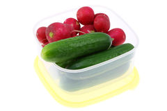 Cucumbers and radishes. Stock Images