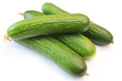 Cucumbers. Some fresh cucumbers on a white background Stock Photos