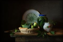 Cucumbers. Still life with salted and fresh cucumbers Stock Image