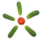 Cucumbers and a tomato are forming Sun Royalty Free Stock Photos