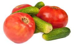 Cucumbers and tomatoes. On a white background Stock Photo