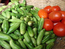 Cucumbers and tomatoes. In a basket on the market close up Royalty Free Stock Image