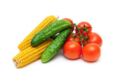 Cucumbers, tomatoes and corn on a white background close-up Royalty Free Stock Photography