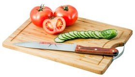 Cucumbers and tomatoes on a cutting board Stock Photography