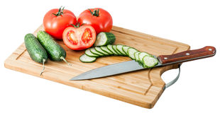 Cucumbers and tomatoes on a cutting board Royalty Free Stock Image