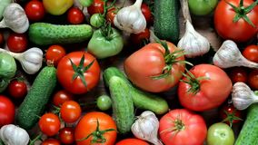 Cucumbers, tomatoes and garlic on the table stock video footage