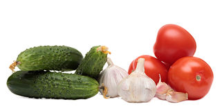 Cucumbers, tomatoes and garlic. Vegetables Stock Photography