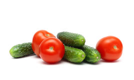 Cucumbers and tomatoes isolated on white background Stock Photo