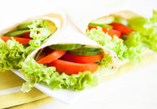 Cucumbers, tomatoes and salad in pita Stock Images