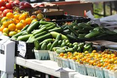 Cucumbers and tomatoes for sale at a farmer's market Royalty Free Stock Image