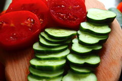 Cucumbers and tomatoes. Are sliced ??cucumbers and tomatoes ready to eat Royalty Free Stock Photo
