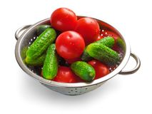 Cucumbers and tomatoes in steel bowl Royalty Free Stock Image