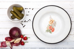Cucumbers vegetables  spices for pickling and vintage metal plate Stock Photography
