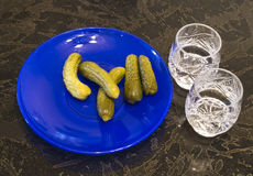 Cucumbers and vodka Royalty Free Stock Photo