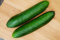 Cucumbers on wooden cutting board Royalty Free Stock Image