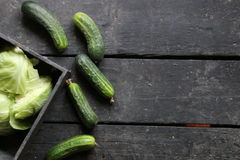 Cucumbers on a wooden surface. Raw Organic food. Royalty Free Stock Image
